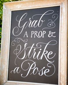 Gorgeous idea for the #props table. #DIY #chalkboard inviting guests to have fun. #rentmyphotobooth Photo via #StyleMePretty