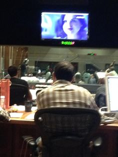 Adam Horowitz watching a scoring session for 4x01; a scene with Regina