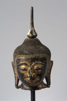 A burmese, shan period, gilt and black-lacquered wood head of buddha sakyamuni circa 18th century. Collection Amory