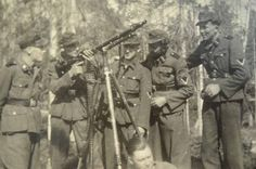 Members of the Pioneer Battalion of the 6th SS Mountain Division Nord with a MG-34 on a AA Mount.