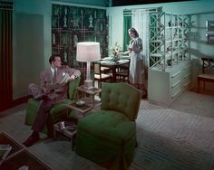 """A folding screen and open shelving act as room dividers in the """"Budget House"""" setting at Marshall Field & Co."""