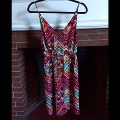 Forever 21 Contemporary multi-patterned dress Forever 21 Contemporary multi-patterned Aztec dress. 70s vintage style. 100% polyester. New with tag. Tag size = Small (S). Comfortably fits 4-6 dress size. Vibrant red, purple, blue and tan colors. Forever 21 Dresses Midi