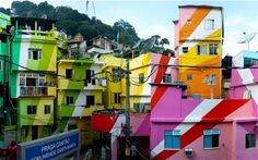 In Santa Marta, Rio, the artists Haas & Hahn painted an entire run-down square in an explosion of candy-coloured