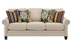 """The Ballari - Linen Sofa from Ashley Furniture HomeStore (AFHS.com). Contrasting the clean light tone of the upholstery fabric with the vibrant colors of the accent pieces, the sleek Vintage Casual design of the """"Ballari-Linen"""" upholstery features beautifully shaped arms that complements the straight-lined design and welting details to create a stunning collection that is sure to awaken any home."""