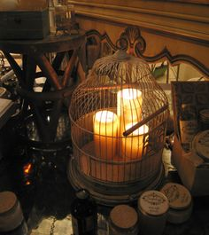 Vintage Bird Cage filled with Candles, great on a pedestal or along the aisle.