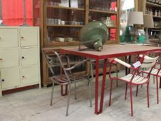 Le Forge Red Industrial Table with Timber Top with Red and Teak French Stackable Chairs. Original French Industrial light. Six door cabinet. All available at Le Forge. 59 Denison Street Camperdown NSW Australia www.leforge.com.au