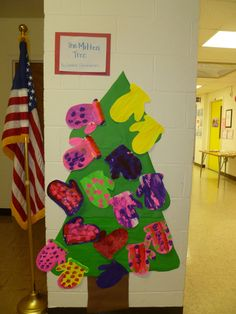 The Mitten Tree by Candace Christiansen...next year's mittens will be smaller.  I threw the tree up on the wall in 5 minutes.  Not everyone chose to work on symmetry.  The free form mittens of different sizes were displayed as art inspired by Jan Brett's The Mitten.