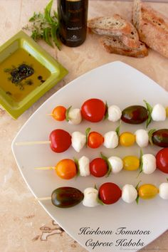Heirloom Tomatoes Caprese Kabobs a simple but delicious #appetizer that everyone will love! #recipes #caprese By www.cookingwithruthie.com