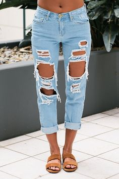 """The """"Jana ripped mom jeans"""" is the stylist pick. Featuring a baggy oversized look, rips across thighs and knees and distressed patches on the back pockets. Pair it with a loose white shirt for a casual summer look or a vintage tee for an edgier look. Size 8 Length:97cm/38inch Width:37cm/14.5inch Cotton Cold Hand Wash Only Model wears a size 8 Model's height 178cm Imported A slight variation may occur in colours and size specifications. Colours may appear slightly di..."""