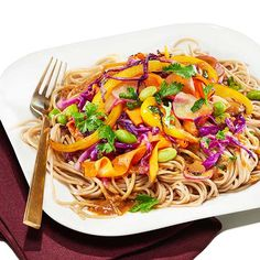Edamame Stir-Fry with Miso - Shape.com Buckwheat noodles Purple cabbage Carrots - peeled Yellow bell pepper Radishes Scallions Rice wine vinegar - 2 tbsp Soy sauce - 1 tbsp Miso paste - 1 tbsp Sesame oil - 2 tbsp  Garlic clove Ginger - fresh, grate Frozen edamame Cilantro (garnish)