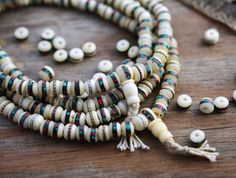 White: 8mm Yak Bone Beads from Nepal inlaid with Turquoise