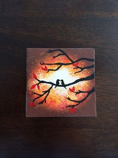 Hand painted mini canvas magnet of two love birds in tree with orange sunburst background with red leaves.  Size 3x3 on Etsy, $19.99