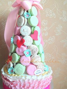 Ruffled cake with Macaron Tower More picture can be found in www.facebook.com/macaronscookiesandcakes