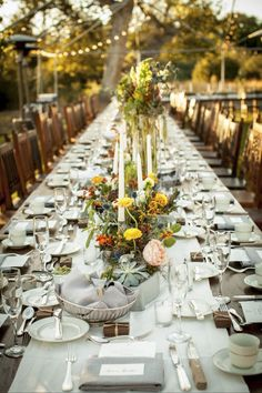 Elegant long table for a reception in hues of yellow + peach & orange.