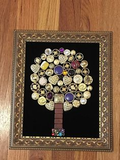 One of a kind collage assembled using recycled jewelry, backed on velvet. Wooden frame sized approximately 8 x 10. Each piece assembled by hand. Ready to hang.
