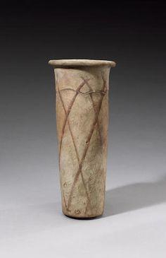 Egyptian Pre-Dynastic 'wavy-handled' cylindrical pottery jar Naqada III, circa 3100 B.C.