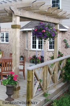 Love this outdoor seating area! See 20+ arbor, trellis, and obelisk ideas for your garden.
