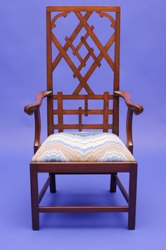 A high-backed fretwork chair made by F.P. Victoria & Son