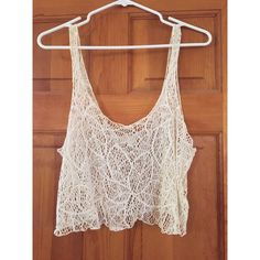 Floral Crop Top Beautiful floral pattern. Can be worn over a bralettee or as a beach cover up. Also great for festival season. Worn once. Excellent condition. It is a large however I typically wear a size small. Fits more like a small. Off white in color. Forever 21 Tops Crop Tops