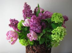 Lilac this Spring All the Spring Favorites:  Tulips, Snowball and Lilac!  This beautiful arrangement will make anyone's eyes and nose smile.  Container may vary.