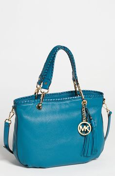 Free shipping and returns on MICHAEL Michael Kors 'Bennet - Medium' Leather Tote at Nordstrom.com. Whipstitched leather trim outlines a slouchy pebbled-leather tote finished with a dangling logo medallion and swishy tassels at one side.