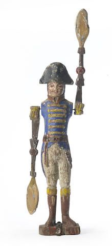 A carved and polychromed soldier whirligig, probably Continental, early 19th century, greatest height 22 7/8in