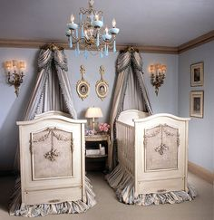 twin baby cribs with luxurious curtain