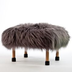 Nia in Slate Grey. A luxury sheepskin footstool handmade in beautiful North Wales, with a removable quirky Slate Grey coloured real British sheepskin cover.