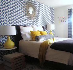 """I wanted this guestroom to feel light and playful. Geometric patterns and whimsical accessories balance the blue and yellow tones."" -George Marrone"