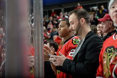 Pierre Thomas of the New Orleans Saints watches the game against the Columbus Blue Jackets.
