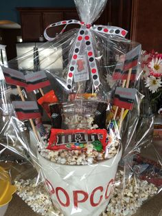 """""""Night at the movies"""" themed basket for school auction. Contains popcorn bowl, DVD, candy, soda, and gift certificates to movie theater."""