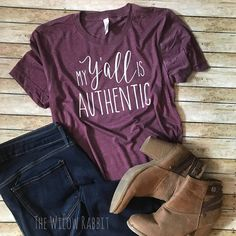 Hey yall!! Yall is such a southern term that others just simply dont understand. This is such a fun t-shirt to show your southern roots and let everyone know, that when you say yall it is authentic!  Pair this relaxed fit tee with a cardigan, denim jacket, or a neutral flannel and throw on your favorite pair of denim, boots or sandals..there are so many options to be stylish and comfortable.  This super soft t-shirt is a beautiful heathered maroon with white heat transfer vinyl that has been…