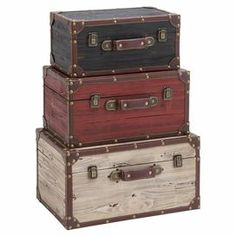 """Add an artful touch to your master suite or living room decor with this set of wood trunks, showcasing vintage-inspired designs.  Product: Small, medium and large trunkConstruction Material: Wood, metal and faux leatherColor: Light brown, maroon and greyFeatures:  Distressed finishNailhead trimLatched lid Dimensions: Small: 7"""" H x 14"""" W x 8"""" DMedium: 8"""" H x 15"""" W x 10"""" DLarge: 9"""" H x 17"""" W x 11"""" D"""