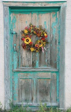 Blue Chipped Paint and Bright Yellow Wreath make this door an eye-pleasing art piece. Do your thing today with wreaths Cool Doors, Unique Doors, Knobs And Knockers, Door Knobs, Orquideas Cymbidium, When One Door Closes, Deco Floral, Painted Doors, Closed Doors