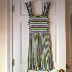 M Missoni 100% Authentic Sleeveless Dress Sz 4 M Missoni 100% Authentic Sleeveless Dress Size 4, colors-gray, pink, white, yellow, Aqua, gently worn, kept in great condition although there is a slight tiny pull on skirt part of dress but can barely see it and probably can be fixed I just didn't want to mess with it, retailed around $895 M by Missoni Dresses