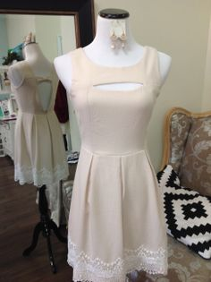 This dress has the cutest boob peep and bow in the back!  S/M/L at sister kate's boutique!
