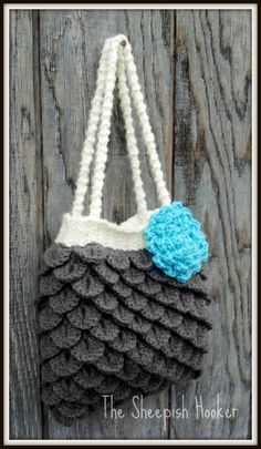 Love the look of this purse, but it's crochet.  May just have to pick up a crochet hook and learn how to crochet.