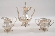 27 TROY OZS.,  3 PIECE STERLING SILVER FOOTED TEA SET