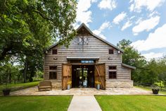 Just outside Houston, Barbara and Bill Hoppe's 19th-century barn is used for entertaining and as a pool house.