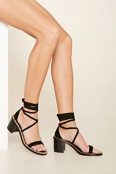 A pair of faux suede heels with an open toe, a lace-up design, studded accents, and a block heel. #stepitup