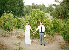 newlyweds in orange field