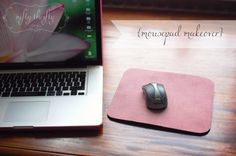 Mousepad makeover-old (falling apart) mousepad, scrap fabric, spray glue, scissors or rotary cutter.  Use spray glue to attach fabric to mouse pad and cut the fabric to size.