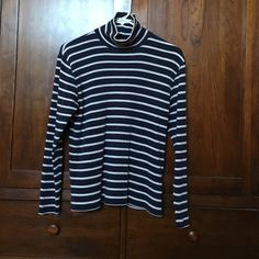 LL Bean French Sailor Turtleneck Navy Perfect year 'round. I wear these as layers why it's cold but especially for an evening on the beach!  Price firm. No holes that k can find. Excellent super soft 100% cotton. Fit true to size. LL Bean Tops Tees - Long Sleeve