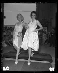Marilyn Monroe and Jane Russell putting footprints in cement at Grauman's Chinese Theater in Los Angeles, Calif., 1953