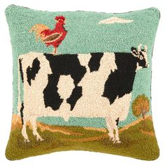 Hand-hooked wool pillow with a rooster and cow motif.   Product: PillowConstruction Material: 100% Wool cover and poly...41