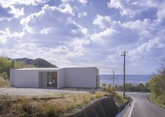 Hillside house by Okuwada Architects Office overlooks the ocean