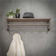 This coat hanger is made from metal with a silver finish. A vintage industrial look. Coat Rack Shelf, Coat Hanger, Coat Racks, Dressing Table New, 3d Folie, Coat Stands, Grey Wash, Wall Shelves, Entryway Bench