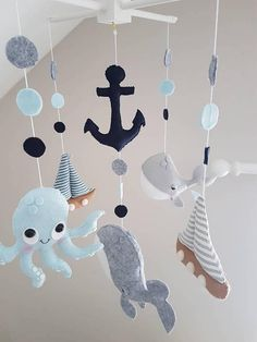 Hello and Welcome to NiNuBo Made To Order Mobile, please check my creation time on my main page before ordering. ⛵ Sail Away Baby Mobile ⛵ I hand make all my mobile from scratch. This mobile is made using wool felt and fabric.Each Plush Toy is stuffed with Polyester Filling and hung on a