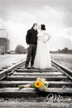 Bride and Groom on the tracks  Photo by Myle Collins  Mylestone Photography  Wedding portrait, wedding pose, couple pose, bride and groom, railroad tracks