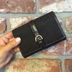 Coach Canvas Wallet Nice size, perfect for inside purse or by itself. Black canvas wallet with silver buckle detail. Fits multiple cards with a zipper coin pocket, even fits iPhone 5s. Coin discoloring in the coin pocket and general wear is pictured. Great for on the go! Coach Accessories